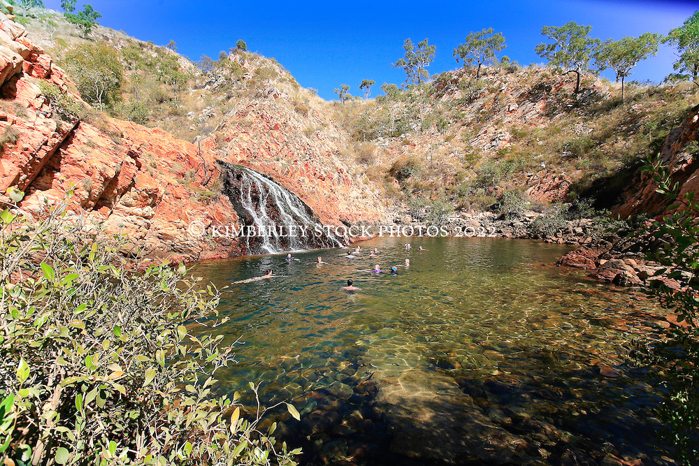 Charter boat passengers swim at Croc Creek on the Kimberley coast.  The waterhole is a popular swimming spot with tourists.