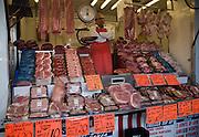 Butcher mobile van meat display at Ipswich market, Suffolk, England