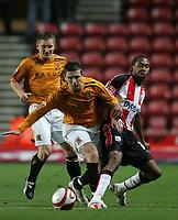 Photo: Lee Earle/Sportsbeat Images.<br /> Southampton v Hull City. Coca Cola Championship. 08/12/2007. Hull's Bryan Hughes (L) battles with Jhon Viafara.