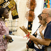 Customers discuss with a vendor at the  22nd Salon International de l'Artisanat de Ouagadougou (SIAO) in Ouagadougou, Burkina Faso on Friday October 31, 2008.