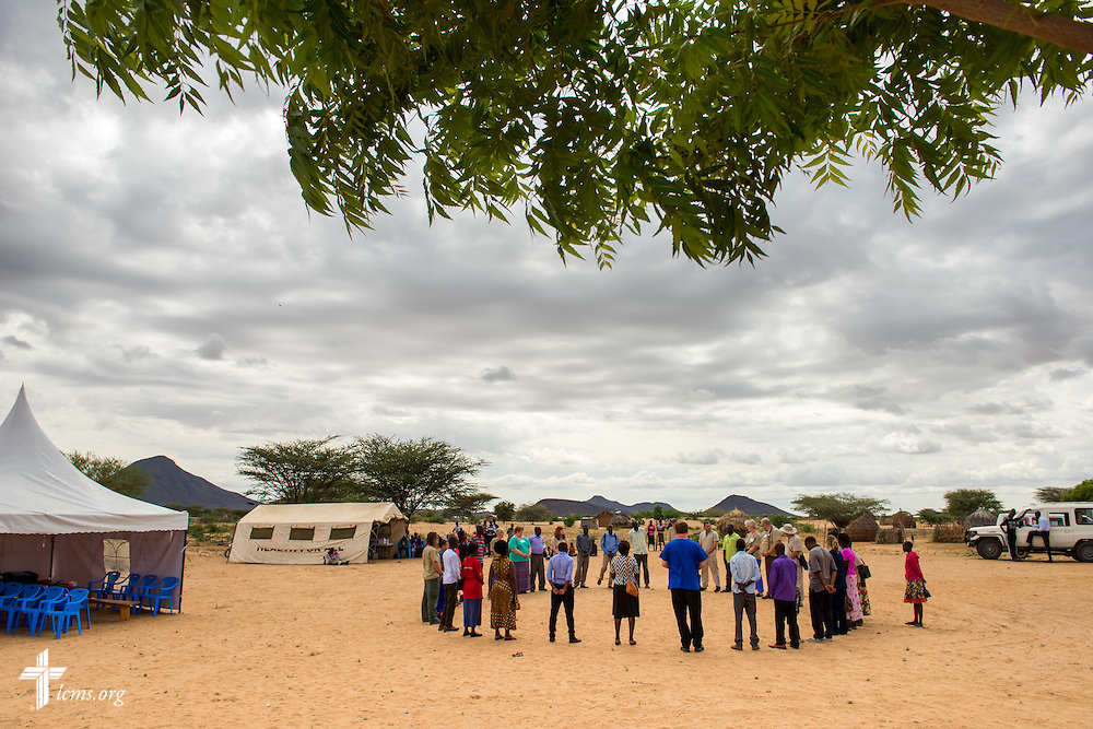 Members of the LCMS Mercy Medical Team and Kenyan medical colleagues pray together on Tuesday, June 21, 2016, in Nataparkakono, a village in Turkana, Kenya.  LCMS Communications/Erik M. Lunsford