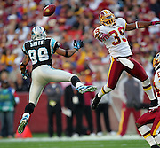 LANDOVER, MD - NOVEMBER 26:  Safety Vernon Fox #39 of the Washington Redskins breaks up a pass intended for wide receiver Steve Smith #89 of the Carolina Panthers at FedExField on November 26, 2006 in Landover, Maryland. The Redskins defeated the Panthers 17-13. ©Paul Anthony Spinelli *** Local Caption *** Vernon Fox;Steve Smith