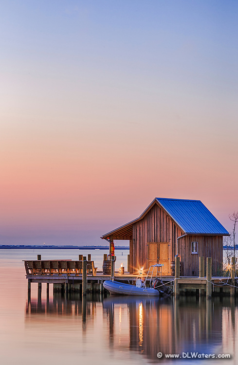 Manteo boathouse on Shallowbag Bay at sunrise.