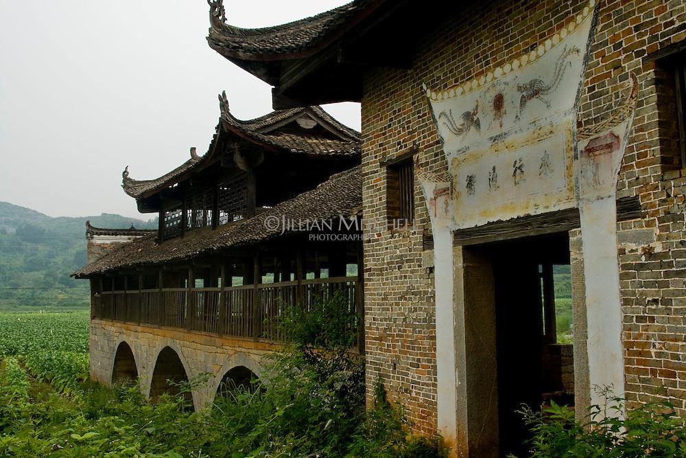 Old wind and rain bridge sits in the fields of Fuchuan Yao autonomous region in Guangxi province, China.