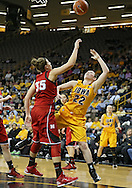 February 11 2013: Iowa Hawkeyes guard Samantha Logic (22) is fouled as she puts up a shot over Nebraska Cornhuskers forward Jordan Hooper (35) during the first half of the NCAA women's basketball game between the Nebraska Cornhuskers and the Iowa Hawkeyes at Carver-Hawkeye Arena in Iowa City, Iowa on Monday, February 11 2013.