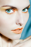beauty portrait close up of a beautiful woman with orange make up