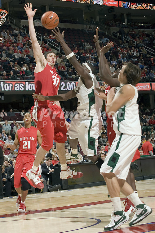 December 18, 2007: Ohio State's Kosta Koufos #31 attempts to block Cleveland State's Cedric Jackson #11 in the  John McClendon Scholarship Classic in Cleveland, Ohio. OSU defeated CSU 80-63. Michael Ciu / CSM