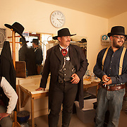 Actors take a break backstage between re-enactments of the infamous gunfight at the OK Corral in Tombstone, Arizona. From left to right: Erik Servia (as Doc Holliday), Kirk Opperman (as Wyatt Earp) and Jeremy Caron (as Ike Clanton).