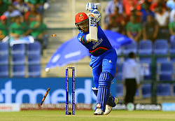 September 20, 2018 - Abu Dhabi, United Arab Emirates - Afghanistan cricketer Rahmat Shah is bowled out during the 6th cricket match of Asia Cup 2018 between Bangladesh and Afghanistan at the Sheikh Zayed Stadium,Abu Dhabi, United Arab Emirates on September 20, 2018. (Credit Image: © Tharaka Basnayaka/NurPhoto/ZUMA Press)