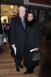SIR MICHAEL & LADY CAINE at a private view to celebrate the opening of the Royal Academy's exhibition of work by David Hockney held at The Royal Academy, Burlington House, Piccadilly, London on 17th January 2012.