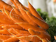 close up of organic carrots displayed at a green market