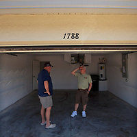 TAMPA, FL -- March 22, 2011 -- Mark Pickett and his brother, Larry, inspect a home for sale in North Port, Fla., 2011.  A recent study showed that one and five homes in the state of Florida is vacant.