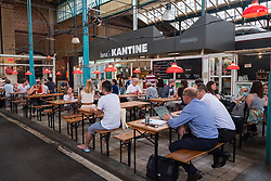 One of many restaurants at at indoor market , Markethalle Neun, Kreuzberg, Berlin, Germany.