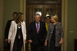 July 28, 2017 - Washington, District Of Columbia, U.S. - Senate Majority Leader Sen. MITCH MCCONNELL (R-KY) leaves the senate chamber accompanied by his staff after the senate voted down republican efforts to repeal The Affordable Care Act 49-51 with 3 republican senators voting against the bill with the democrats. (Credit Image: © Alex Edelman via ZUMA Wire)