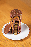 Stack of chocolate biscuits in plate