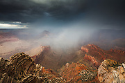 Rain from the summer monsoon falling into the Grand Canyon.