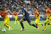 FOOTBALL - FRIENDLY GAMES 2012/2013 - TROPHEE DE PARIS - PARIS SAINT GERMAIN v FC BARCELONA - 4/08/2012 - PHOTO JEAN MARIE HERVIO / REGAMEDIA / DPPI - ZLATAN IBRAHIMOVIC (PSG) / CARLES PUYOL (BAR)