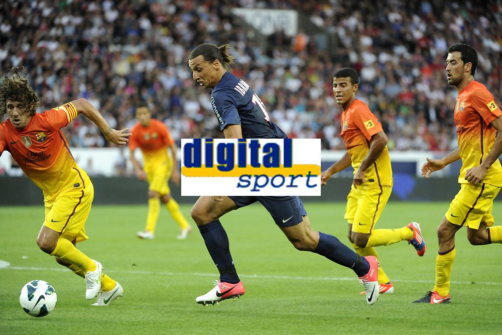 FOOTBALL - FRIENDLY GAMES 2012/2013 - TROPHEE DE PARIS - PARIS SAINT GERMAIN v FC BARCELONA - 4/08/2012 - PHOTO JEAN MARIE HERVIO / REGAMEDIA / DPPI - ZLATAN IBRAHIMOVIC (PSG) / CARLES PUYOL (BAR)