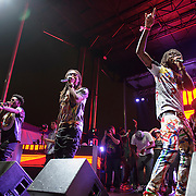 "WASHINGTON, DC - August 23rd, 2014 - Quavo , Offset and Takeoff of Atlanta rap trio Migos perform at the 3rd annual Trillectro Music Festival at RFK Stadium in Washington, D.C. The group is known for their singles ""Versace"" and ""Hannah Montana."" (Photo by Kyle Gustafson / For The Washington Post)"