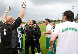 Goalkeeper of Olimpija Robert Volk and Boris Ferencak celebrate after football match of 2nd SNL between NK Olimpija Ljubljana and NK Zagorje, on May 03, 2009, in ZAK stadium, Ljubljana, Slovenia. Olimpija won 9:0 and 4 Rounds before the end won the 1st place in 2nd SNL. Next year they will play in First Slovenian League. (Photo by Vid Ponikvar / Sportida)