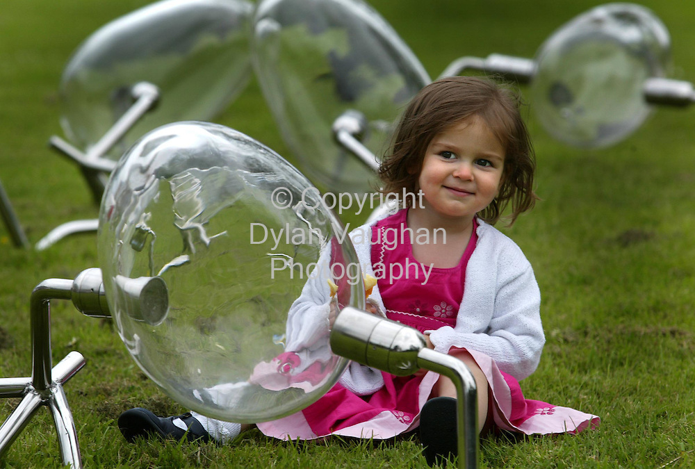 "6/7/2002 .Pictured at the opening of The International Glass Art Festival ""Artist in Glass"" in Waterford was Isobel Strudwick aged 2 with some work by Belgian Artist Koen Vanmechelem called "" Walking Eggs 2001"".Picture Dylan Vaughan"