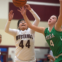 Ramah Mustang Kaycee Lalio (44) attempts to catch the ball from a teammate but is blocked by Mora Ranger Maria Garcia (4) Friday in Ramah.
