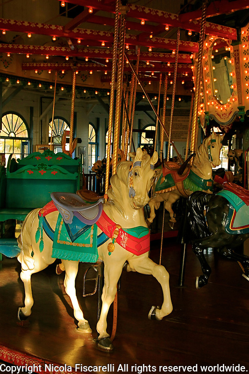 A  beautiful   historic Carousel housed in the Looff's Pleasure Pier Building in Santa Monica California .