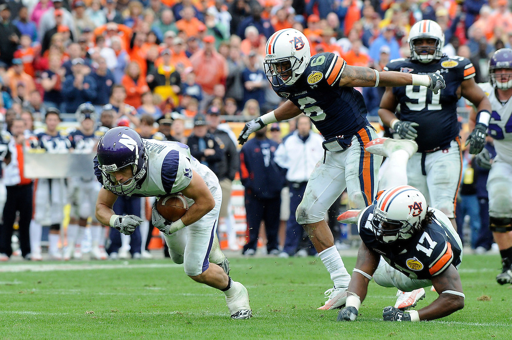 January 1, 2010: Zeke Markshausen of the Northwestern Wildcats in action during the NCAA football game between the Northwestern Wildcats and the Auburn Tigers in the Outback Bowl. The Tigers defeated the Wildcats 38-35 in overtime.