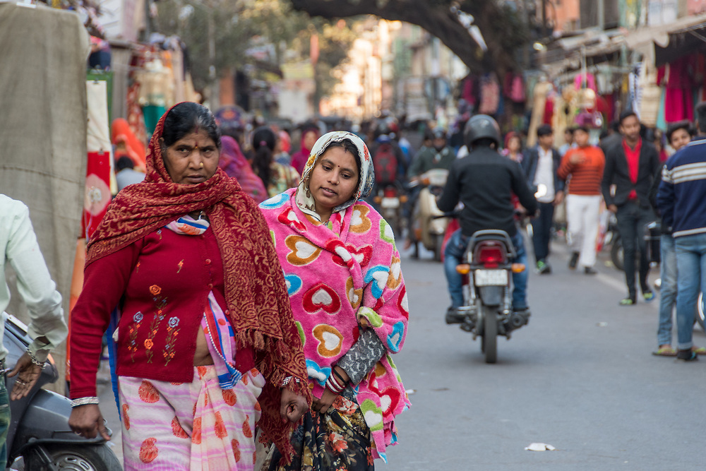 Johri Bazaar; Indian women walking down street in Jaipur, India