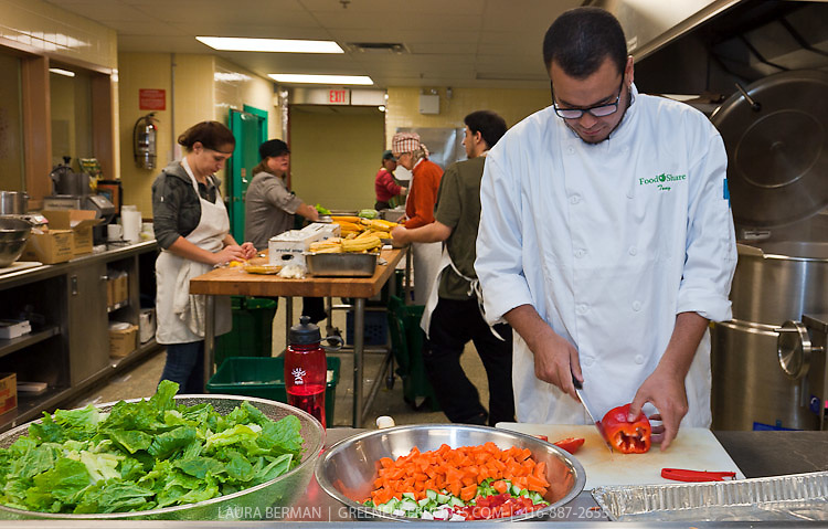 Staff and volunteers prepare food for lunch and the Good Food Box  in FoodShare Toronto's kitchen.