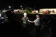 07 September 2010: Brookline Fire Chief Larry Mcconnell talks with reporters about the fire that broke out at Atomic Fireworks early in the morning. Mcconnnell states there was minimal damage to the structure. Witnesses say they saw two individuals running from the building just prior to the fire taking place. Credit: David Welker / TurfImages.com .