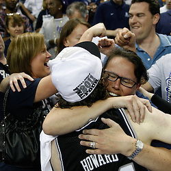 Mar 26, 2011; New Orleans, LA; Butler Bulldogs forward Matt Howard (54) celebrates with his family following a win over the Florida Gators in the semifinals of the southeast regional of the 2011 NCAA men's basketball tournament at New Orleans Arena. Butler defeated Florida 74-71.  Mandatory Credit: Derick E. Hingle