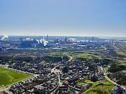 Nederland, Noord-Holland, Wijk aan Zee, 23-03-2020; dorp aan de Noordzee met de karakteristieke dorpsweide. In de achtergrond het staalbedrijfTata Steel(het vroegereHoogovens). Dochteronderneming Harsco, aan de grens van het industrieterrein, verwerkt slikken uit de staalfabriek veroorzaakt regelmatig grafietregens in Wijk aan Zee.<br /> Village on the North Sea with the characteristic village meadow. In the background the steel company Tata Steel (formerly Hoogovens). On the border of the industrial area, the Harsco factory processes mud from the steel factory and causes graphite rains in Wijk aan Zee.<br /> <br /> luchtfoto (toeslag op standaard tarieven);<br /> aerial photo (additional fee required)<br /> copyright © 2020 foto/photo Siebe Swart