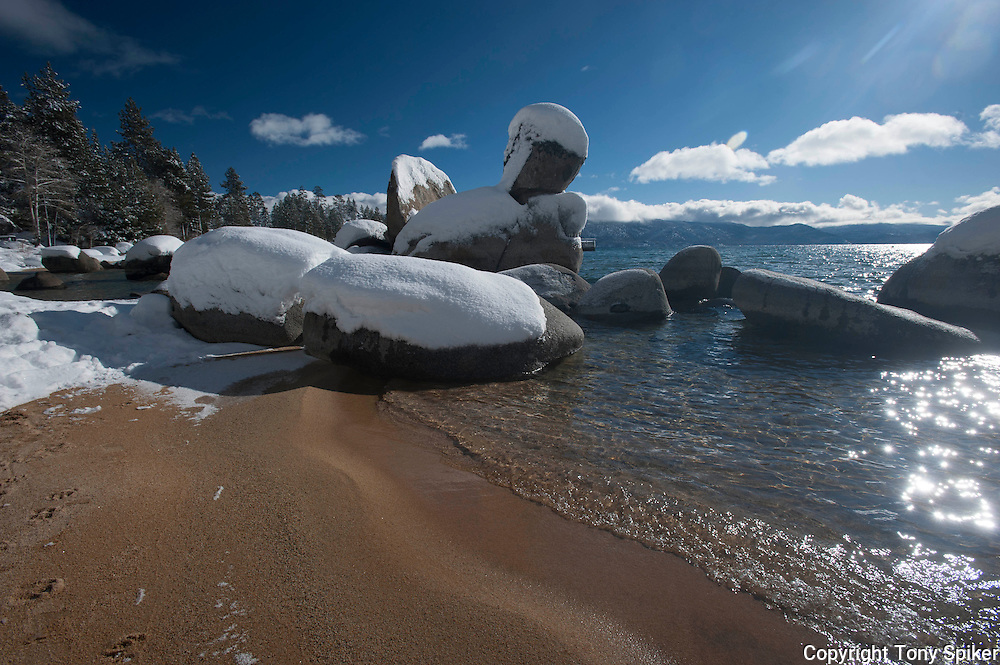 """Winter at Speedboat Beach 1"" - A landscape photograph of snow covered boulders taken at Speedboat Beach, Lake Tahoe after a winter storm"