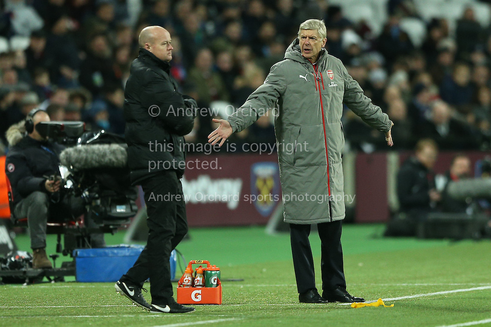 Arsene Wenger, the Arsenal manager argues with an official.Premier league match, West Ham Utd v Arsenal at the London Stadium, Queen Elizabeth Olympic Park in London on Saturday 3rd December 2016.<br /> pic by John Patrick Fletcher, Andrew Orchard sports photography.