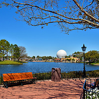 World Showcase Lagoon at Epcot in Orlando, Florida<br /> The eleven country pavilions at Epcot are positioned in an irregular circle around a 40 acre, manmade lagoon. The promenade encircling the lake is 1.2 miles. That does not sound like a long distance. However, you will walk much further as you weave in and out of all the historic replicas, attractions, shops, restaurants and gardens. When you get tired along the way &ndash; and you will &ndash; there are plenty of spots like this to rest awhile and enjoy the view.