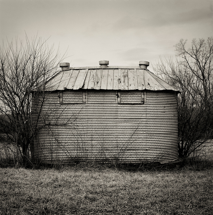 This little metal corn crib in Kentucky seemed to have so much personality and stoicism as it quietly withstood time, rust and neglect.