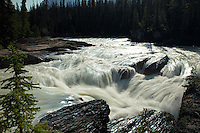 Rushing waters flower down the Kicking Horse River in Yoho National Park, British Columbia
