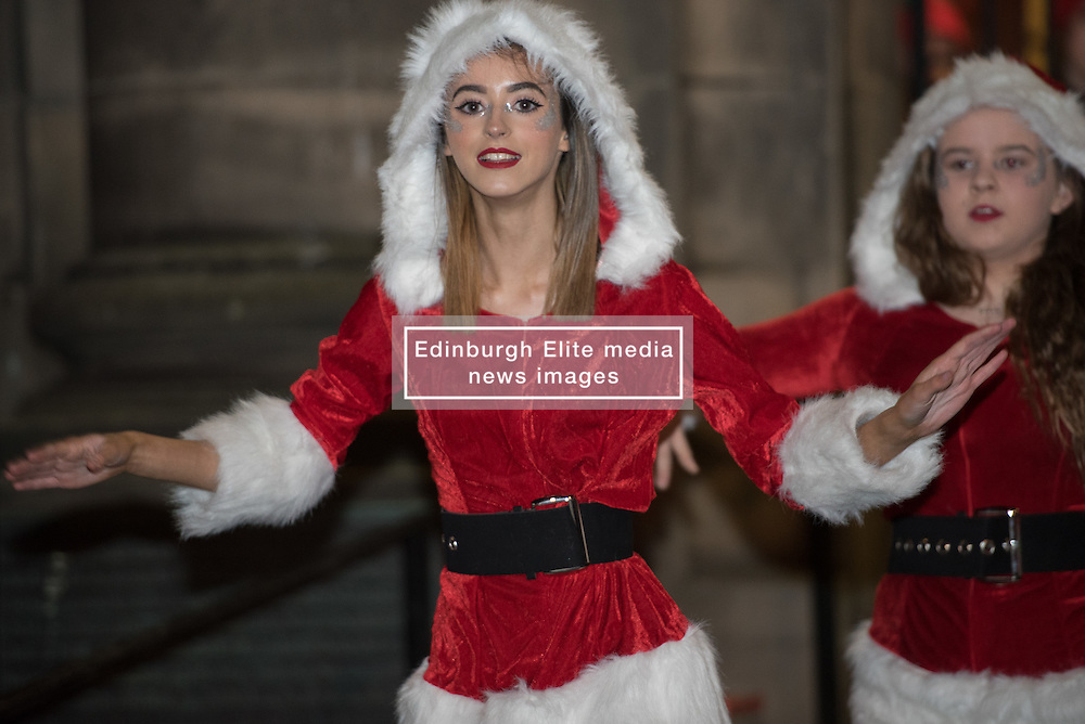 Edinburgh council may have cut the budget for Christmas street lights in various Edinburgh communities but the people of Portobello didn't let that dampen their spirits last night as they celebrated turning on the Christmas Tree lightsin front of Portobello Town Hall.<br /> © Jon Davey/ EEm Edinburgh council may have cut the budget for Christmas street lights in various Edinburgh communities but the people of Portobello didn't let that dampen their spirits last night as they celebrated turning on the Christmas Tree lights in front of Portobello Town Hall.<br /> © Jon Davey/ EEm