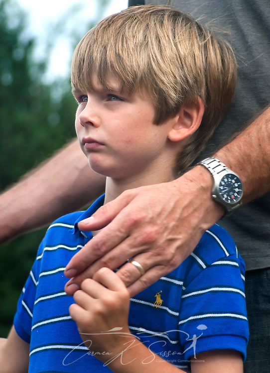 Simon Thames, 7, holds his father's hand during a ceremony commemorating the fifth anniversary of Hurricane Katrina Aug. 29, 2010 in Gulfport, Miss. Approximately 231 people died in Mississippi during the storm. (Photo by Carmen K. Sisson/Cloudybright)