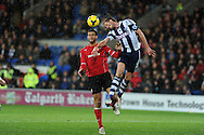 WBA's Jonas Olsson ® beats Cardiff's Steven Caulker to a header. Barclays Premier league, Cardiff city v West Bromwich Albion at the Cardiff city Stadium in Cardiff, South Wales on Saturday 14th Dec 2013. pic by Andrew Orchard, Andrew Orchard sports photography.
