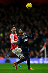 Man Utd Defender Patrice Evra (FRA) is challenged by Arsenal Forward Olivier Giroud (FRA) - Photo mandatory by-line: Rogan Thomson/JMP - 07966 386802 - 12/02/14 - SPORT - FOOTBALL - Emirates Stadium, London - Arsenal v Manchester United - Barclays Premier League.