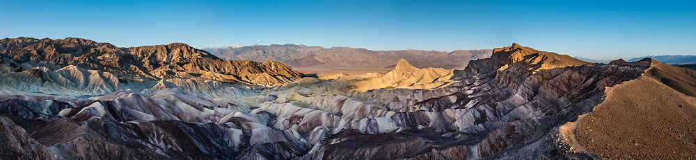 Manly Beacon at sunrise seen from above Zabriskie Point in Death Valley National Park, California, USA. This image was stitched from multiple overlapping photos.