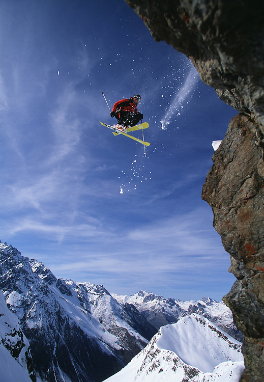 Skier jumping off a cliff 360, low angle view, Serre Chevalier ski resort, France ....Pic. Mike truelove