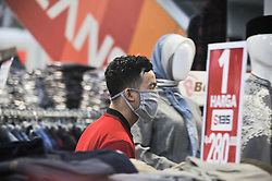 A salesman seen wearing mask while working at the Ramayana shooping centre in Medan, Indonesia on April 19, 2020 amid Corona Virus Disease-19 (DOVID-19) outbreak. The Indonesian government urges the nation to maintained the new health protocols in daily life as the physical and social distance during carrying out economic activities amid the COVID-19 outbreak and towards the holy Ramadan. Photo by Sutanta Aditya/ABACAPRESS.COM