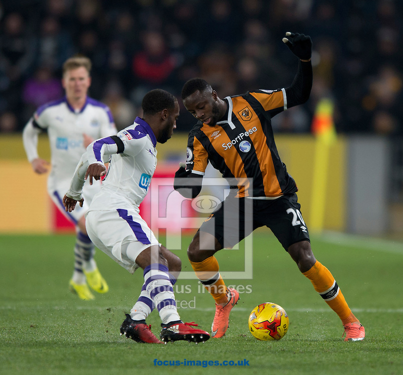 Adama Diomande of Hull City (right) turns inside Vurnon Anita of Newcastle United during the EFL Cup match at the KCOM Stadium, Hull<br /> Picture by Russell Hart/Focus Images Ltd 07791 688 420<br /> 29/11/2016