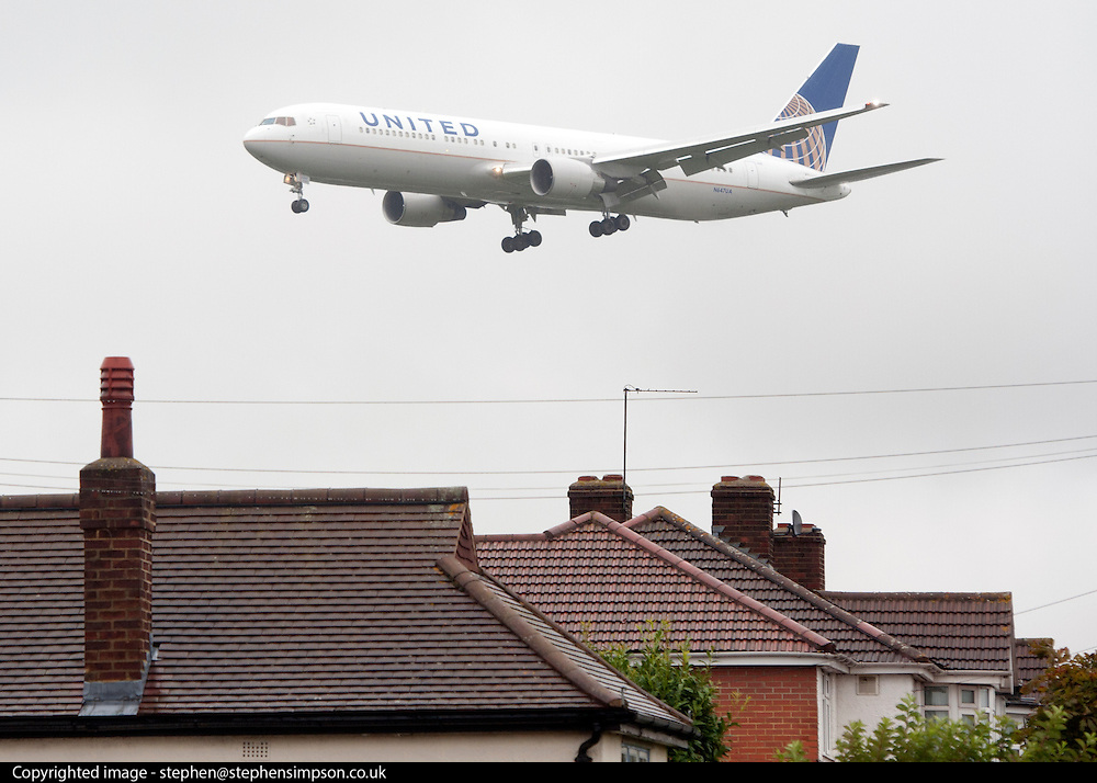 """© Licensed to London News Pictures. 01/09/2014. Bedfont, UK TODAY PICTURE. Planes land at Heathrow airport on 1st September 2014. Mayor of London, Boris Johnson, has issued a last ditch appeal in his battle to prevent a third runway being built at Heathrow, insisting it would be """"barbarically contemptuous"""" of local residents.  Photo credit : Stephen Simpson/LNP"""