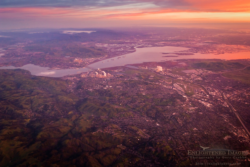 Aerial at sunrise over Pleasant Hill, Martinez, Susuin Bay, and the Carquinez Strait, California