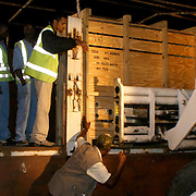 January 29, 2004 - A crate containing a rare mountain bongo is loaded onto a truck at the Jomo Kenyatta International airport in Nairobi before it will be transported to the Mount Kenya Game Ranch in central Kenya. 18 bongos bred in the United States have for the first time in 38 years been returned to their natural habitat in Kenya in a major step to save the species from extinction. Photo by Evelyn Hockstein
