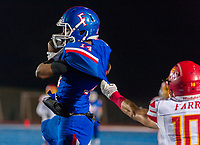 Folsom Bulldogs Elijhah Badger (14), catches the ball for a touchdown to tie the game 7-7 after the point after attempt was good during the first quarter as the Folsom Bulldogs host the Jesuit Marauders in the Sac-Joaquin Section Division I third round playoff game, Friday Nov 24, 2017. <br /> photo by Brian Baer